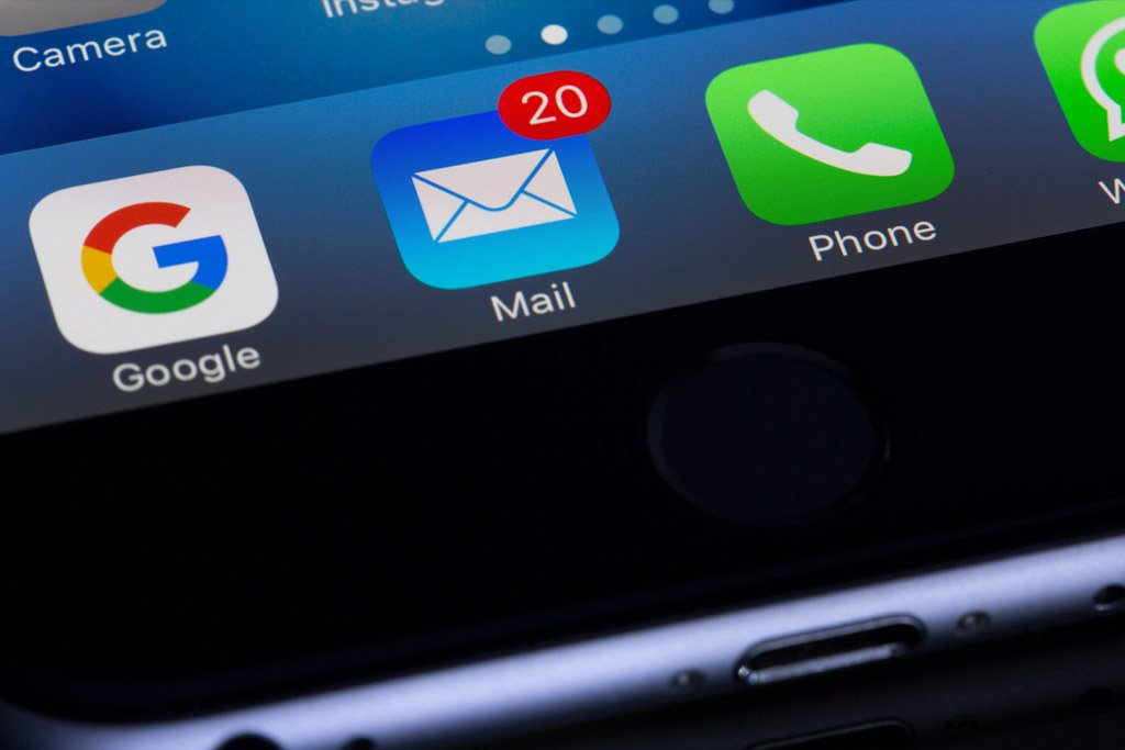 iPhone with the mail app on the dock