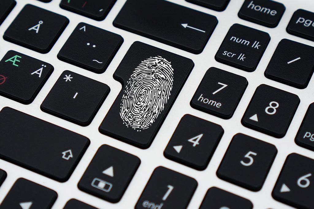 key on a keyboard with a fingerprint as a key