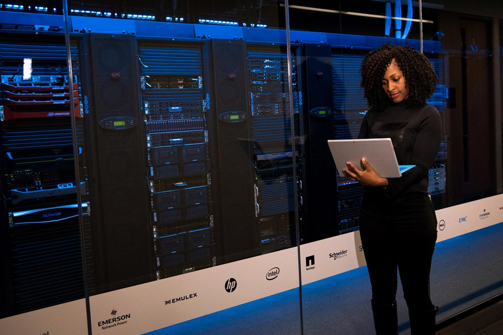person working on a server rack