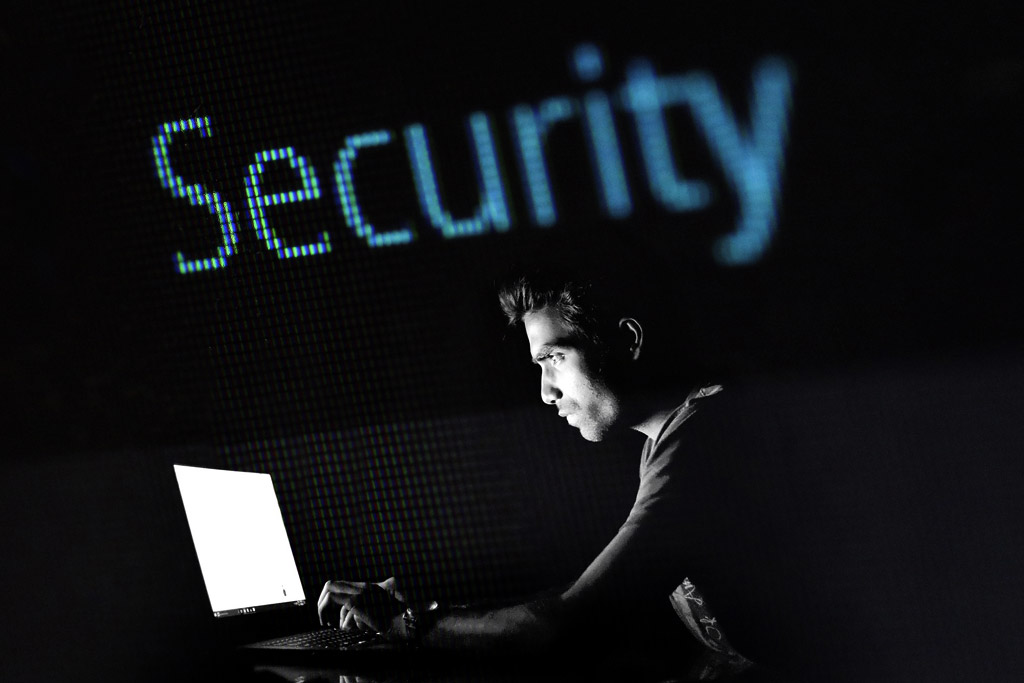 person hacking with the word security behind them