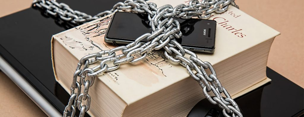 a chain locked onto some phones computers and books